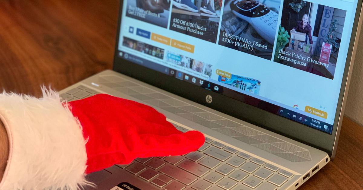 Free ShopRunner membership and 2-day shipping – Santa using a laptop