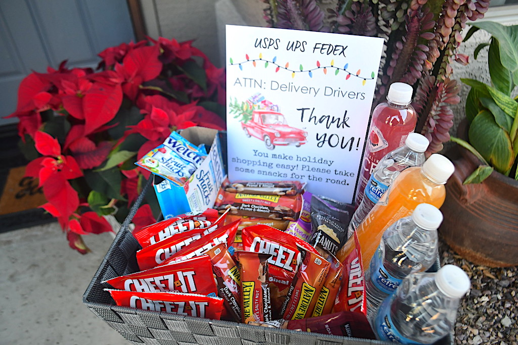 basket of snacks outside door for delivery drivers with sign