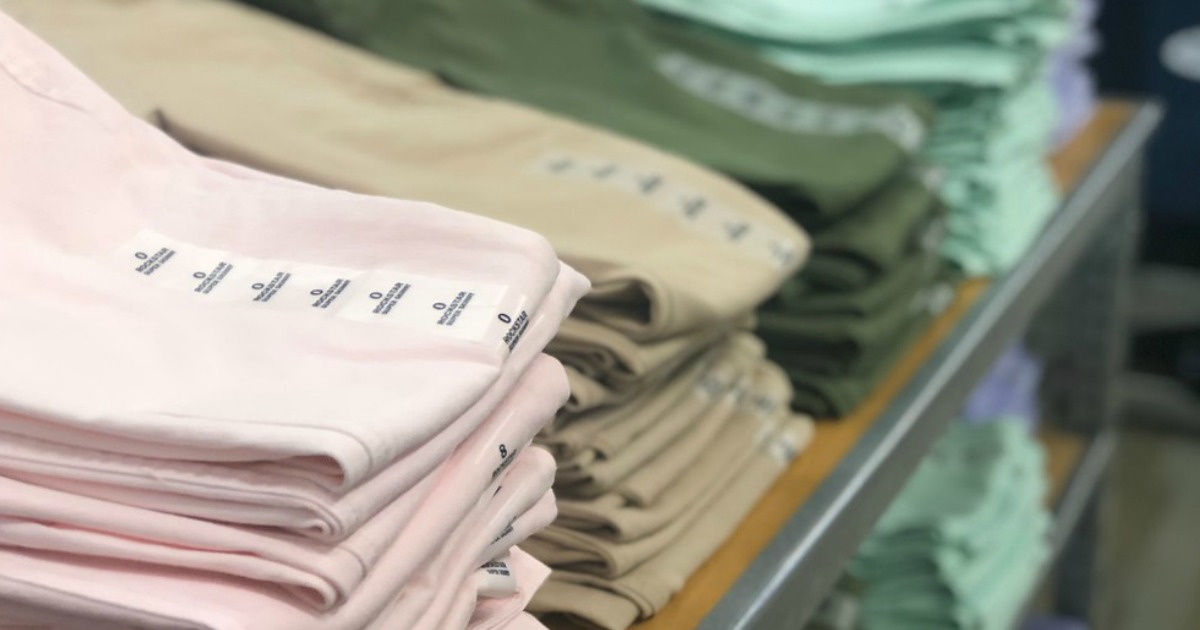 folded pants on display in a store