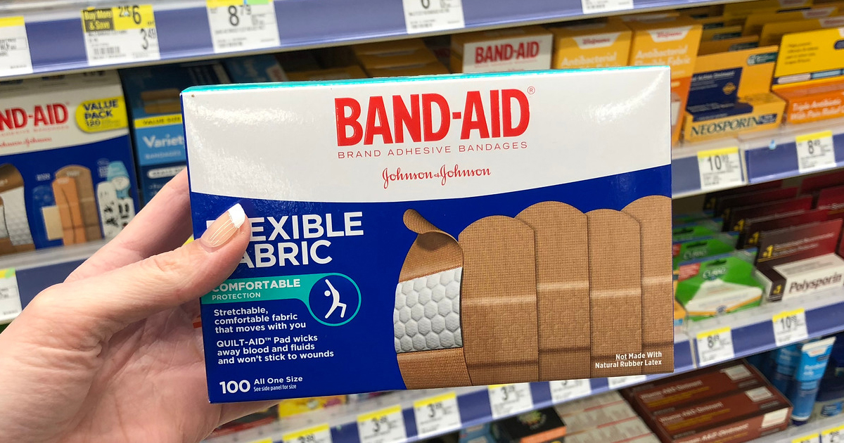 hand holding box of band-aids