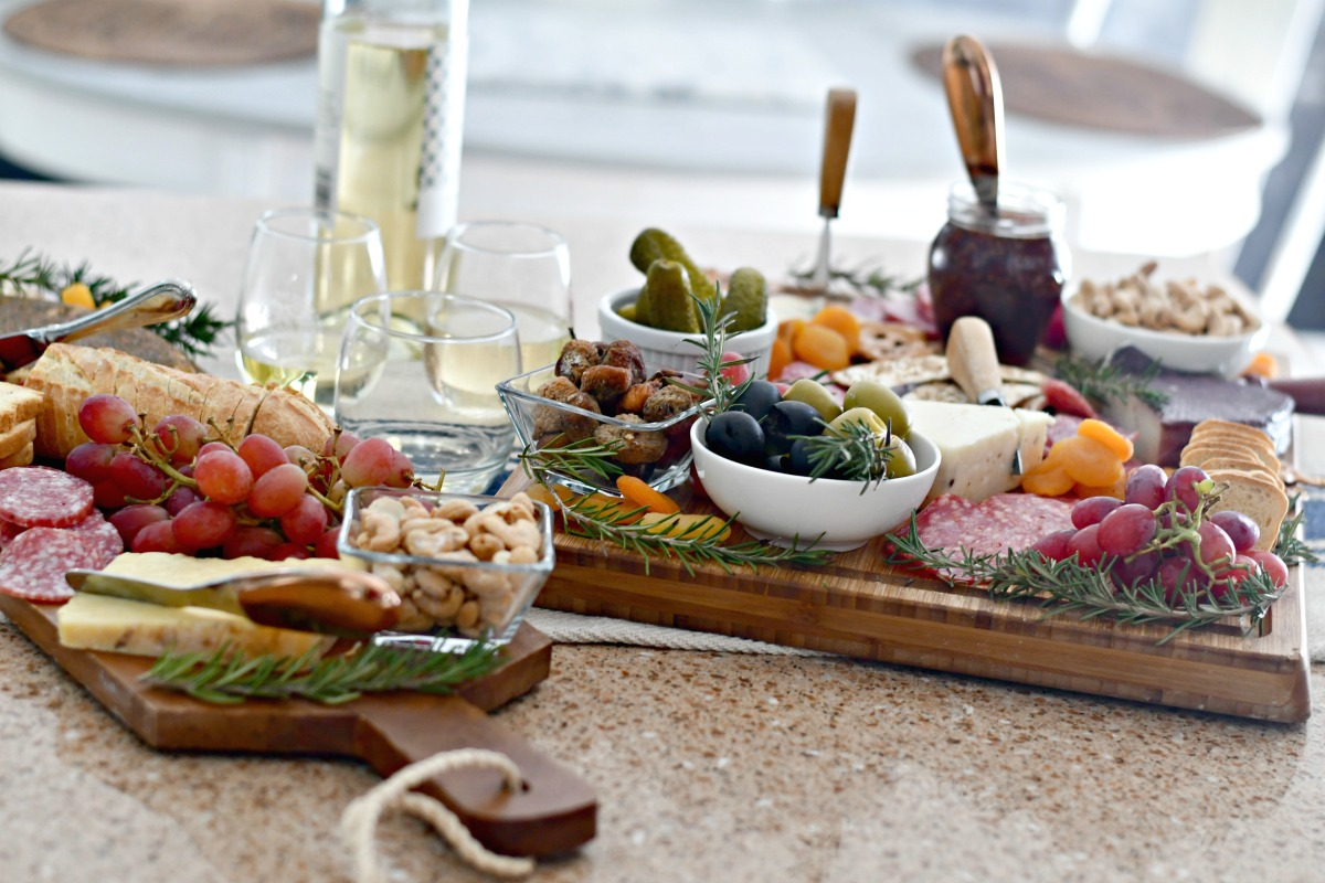 best easy charcuterie board – two trays nuts, dried fruit, jam, cheese, olives, meat, and cheese