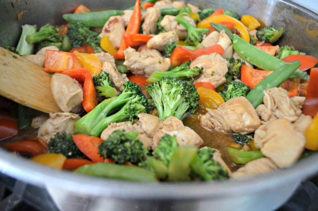 chicken stir-fry on the stove with veggies