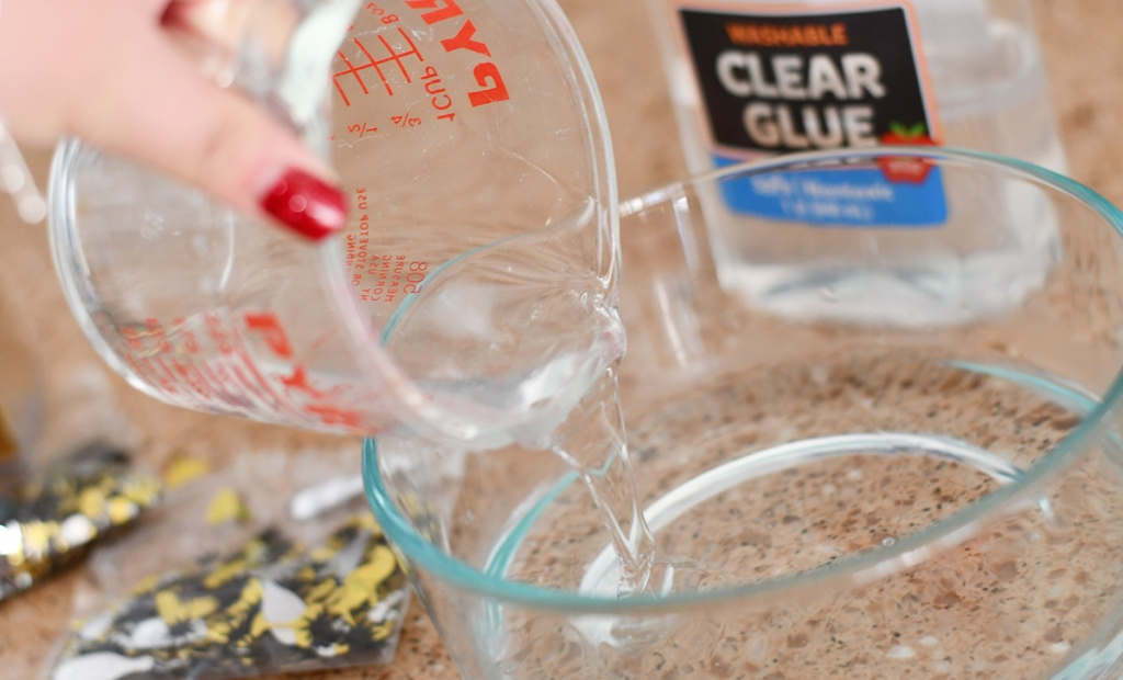 pouring clear glue into a bowl
