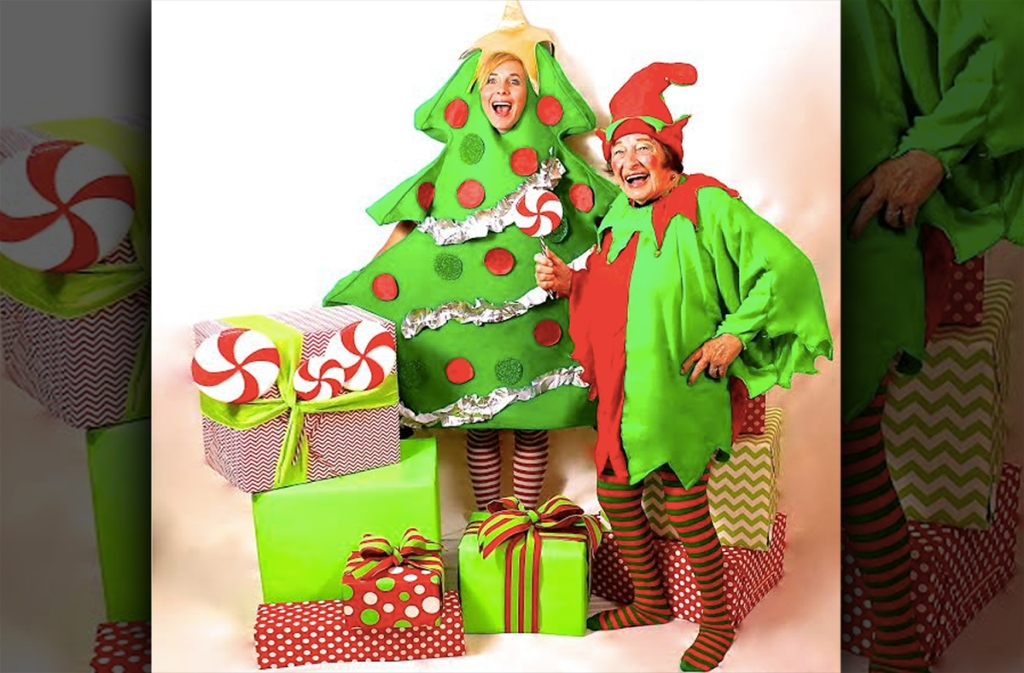 collin wearing christmas tree costume and ma in elf suit with christmas presents