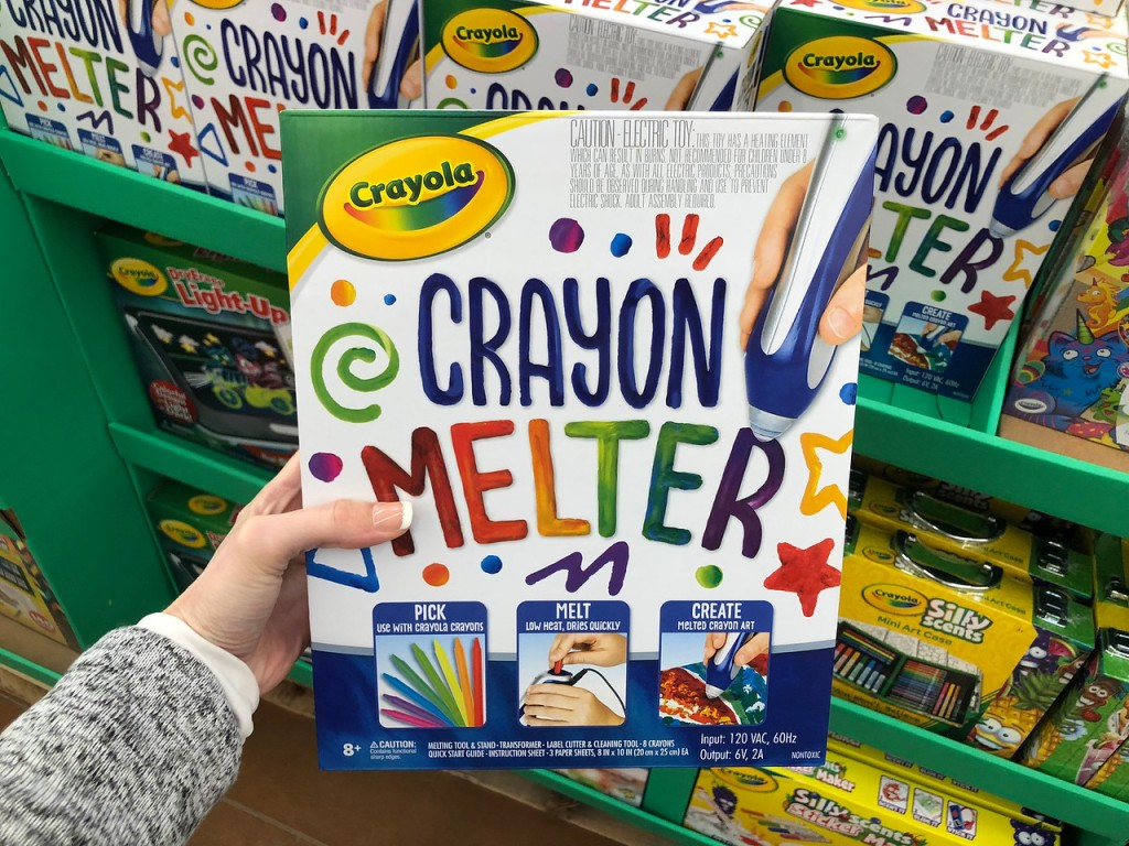 hand holding crayola crayon melter