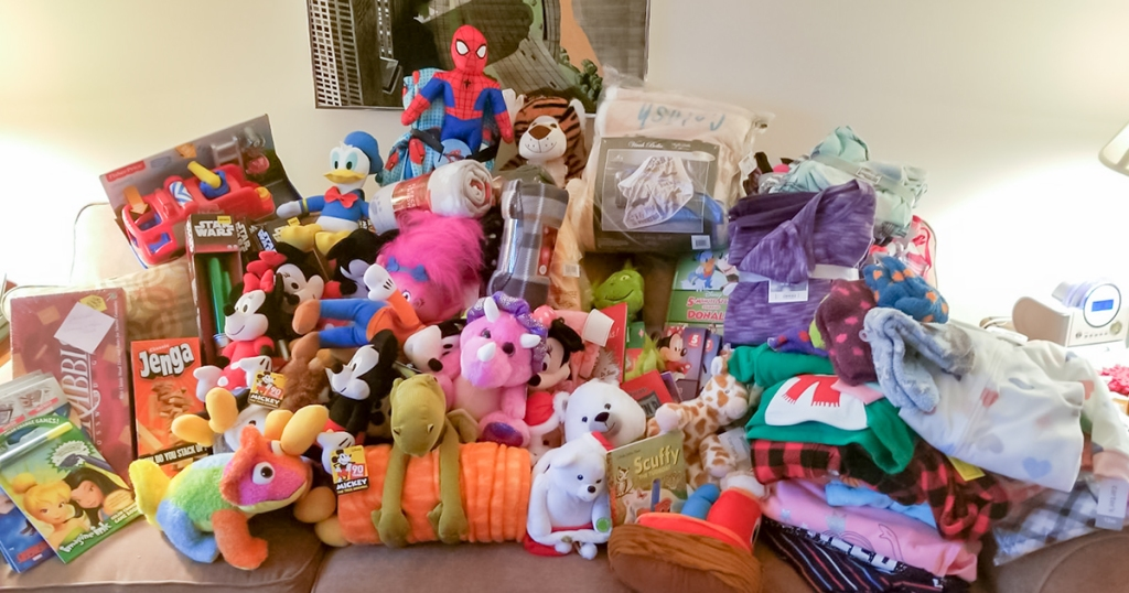 reader giving back —stuffed animal pile from tree trimming party for project night night