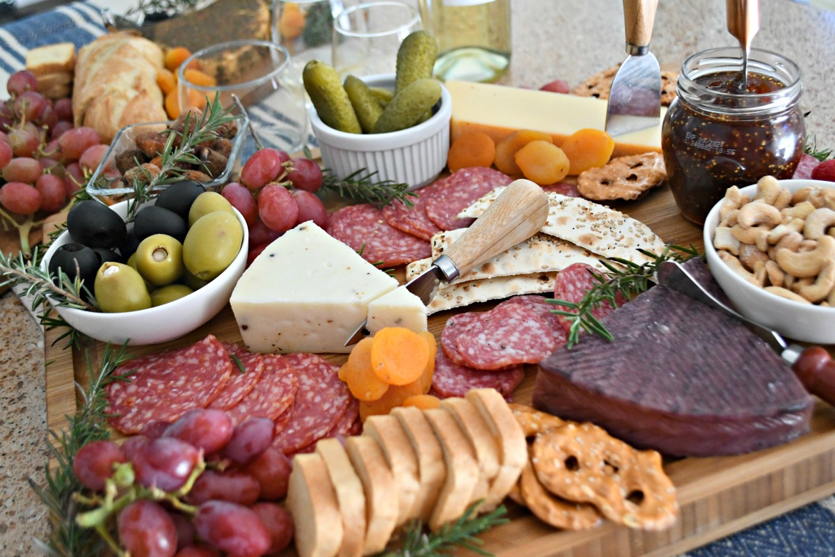 best easy charcuterie board – nuts, dried fruit, jam, cheese, olives closeup of the tray
