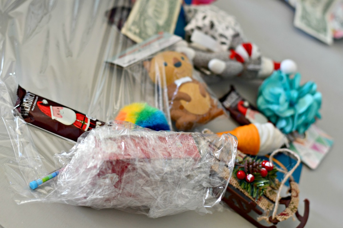 Saran wrap game holiday party game – a partially wrapped ball and items inside