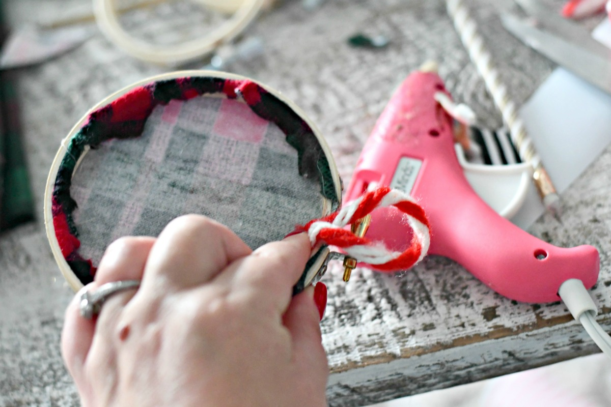 DIY Embroidery Hoop Christmas Ornaments – hot gluing the ribbon