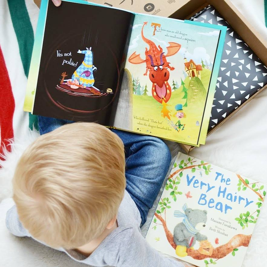 lillypost kids books subscription box promo code deal – young boy reading a book