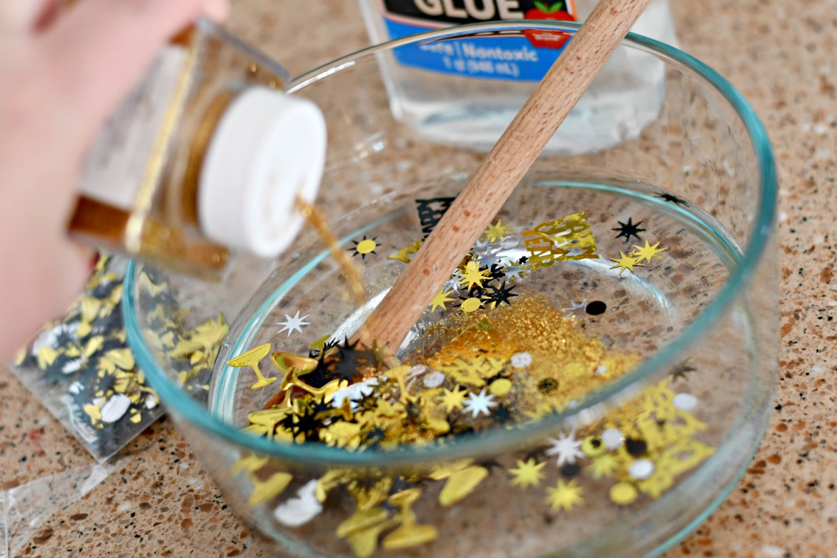 DIY New Year's Clear Slime Recipe – adding glitter to the ingredients