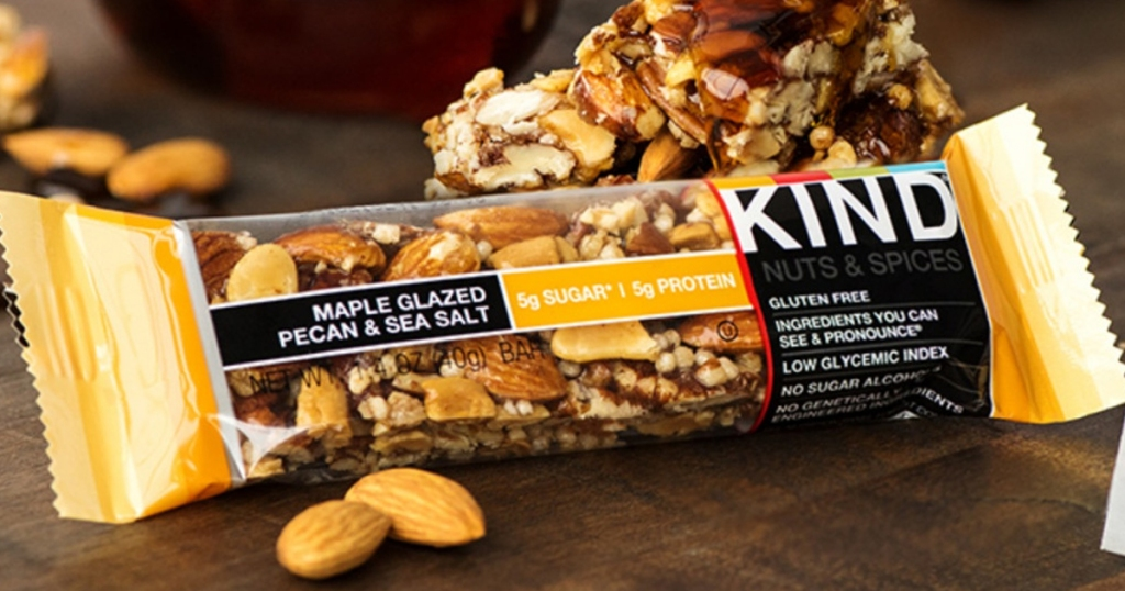 KIND Bar with nuts around it