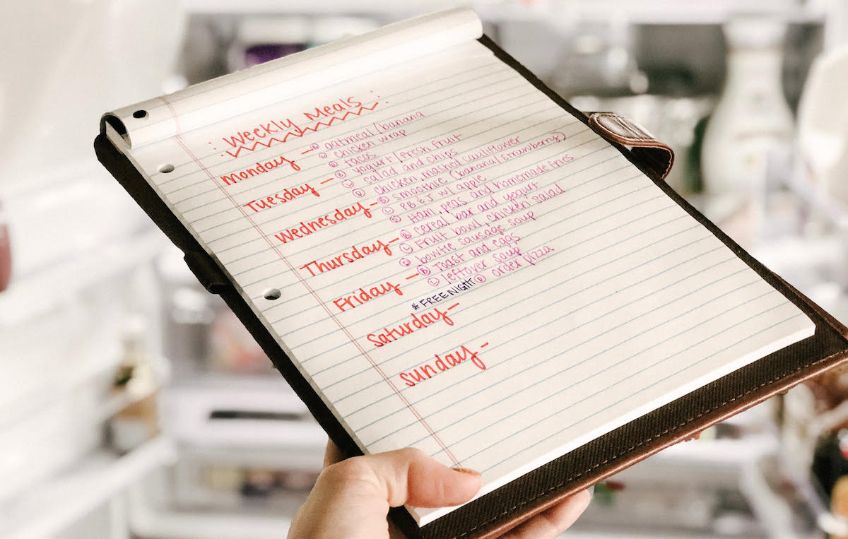 save more money 2019 easy tips – meal planning menu on a clipboard