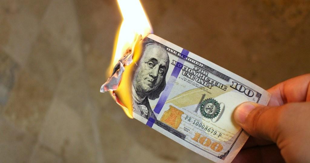 $100 bill burning on fire