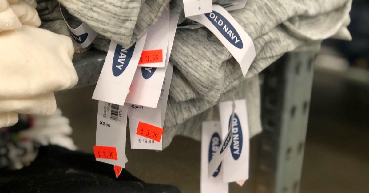 pile of Old Navy clothing with clearance tags