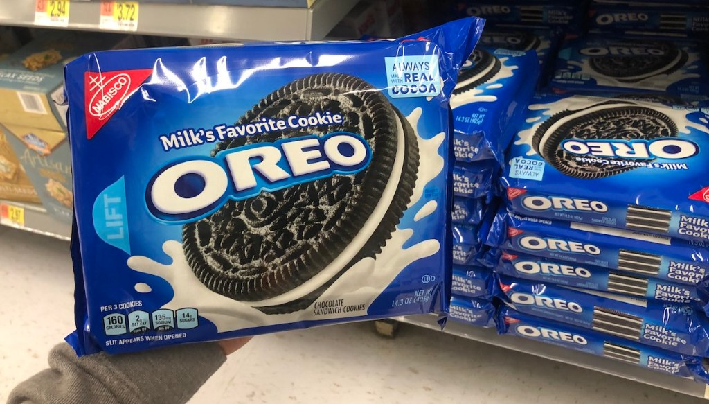 hand holding package of oreos