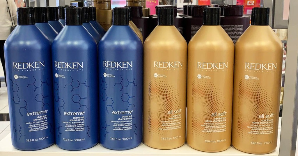 Redken shampoo and conditioner on store shelf