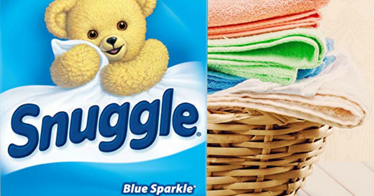 Snuggle dryer sheets next to a basket of towels