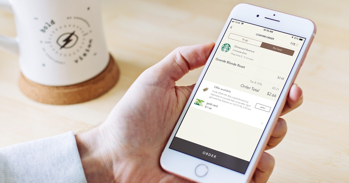 woman holding iphone with starbucks order in app