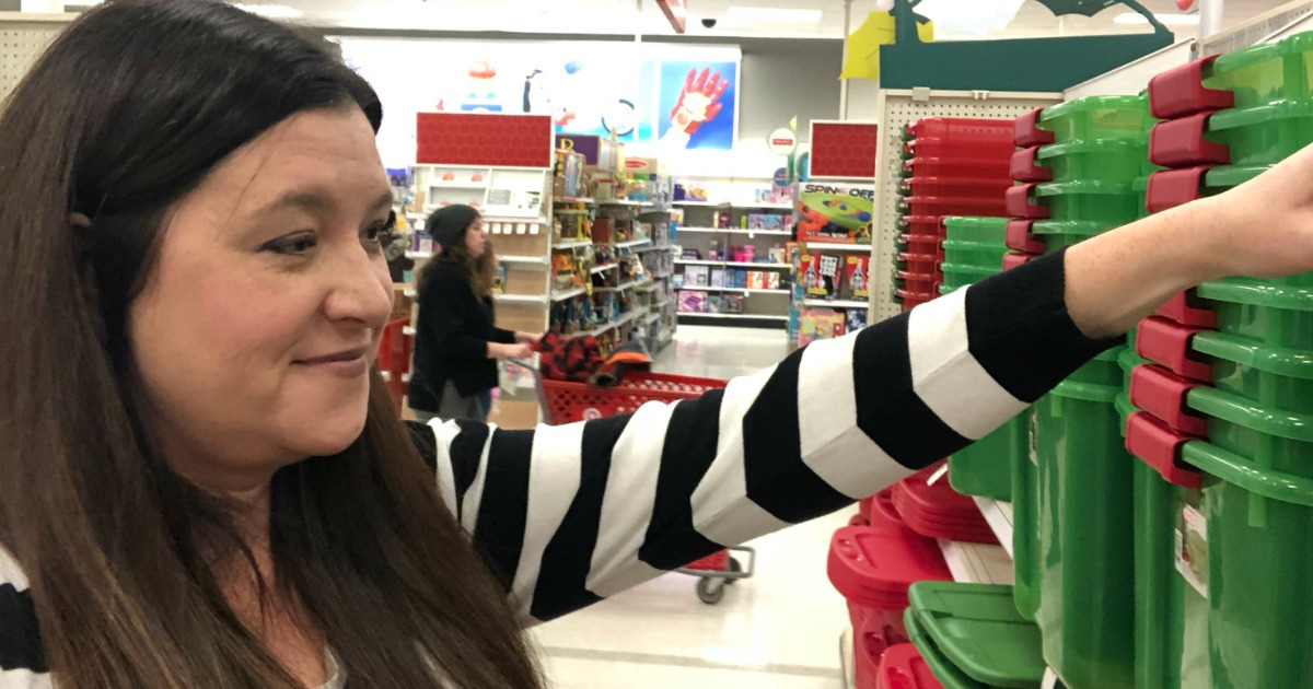 woman looking at Christmas storage bins in Target