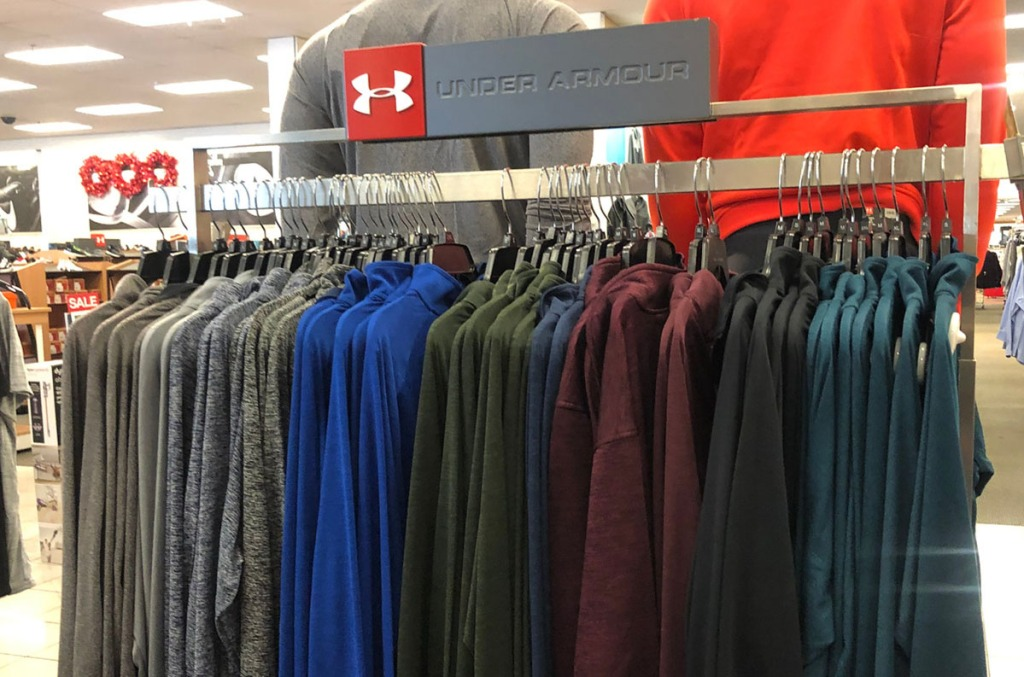 under armour long sleeve jackets hung up on rack