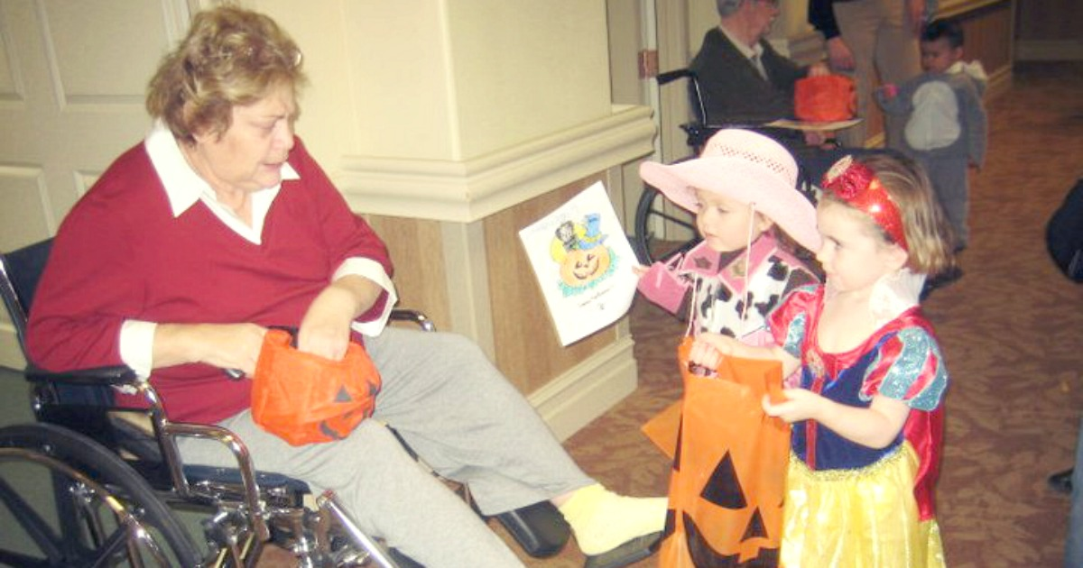 kids trick-or-treating with the elderly