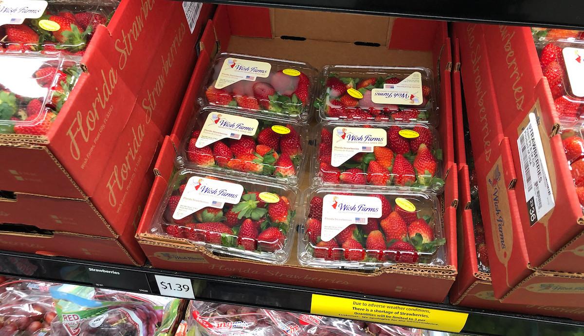 fresh cartoons of strawberries on store shelf