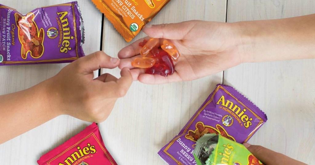 kids handing off fruit snacks