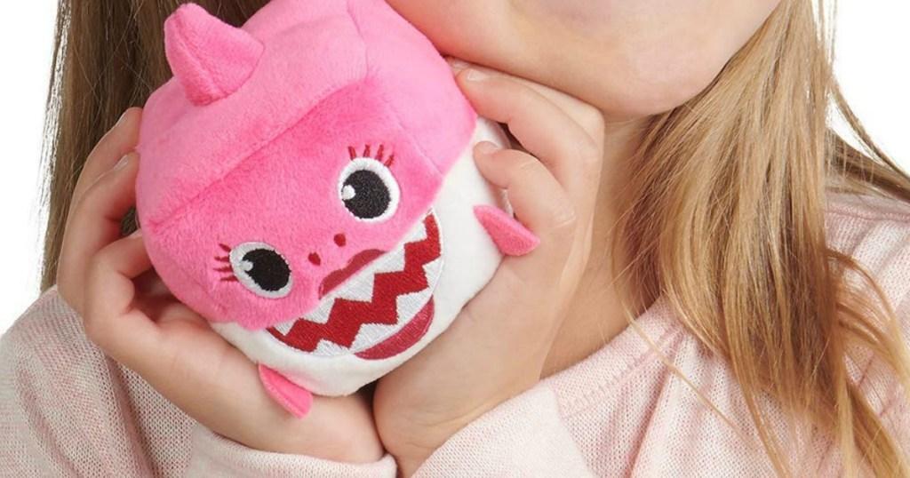 girl holding baby shark song cube mommy shark