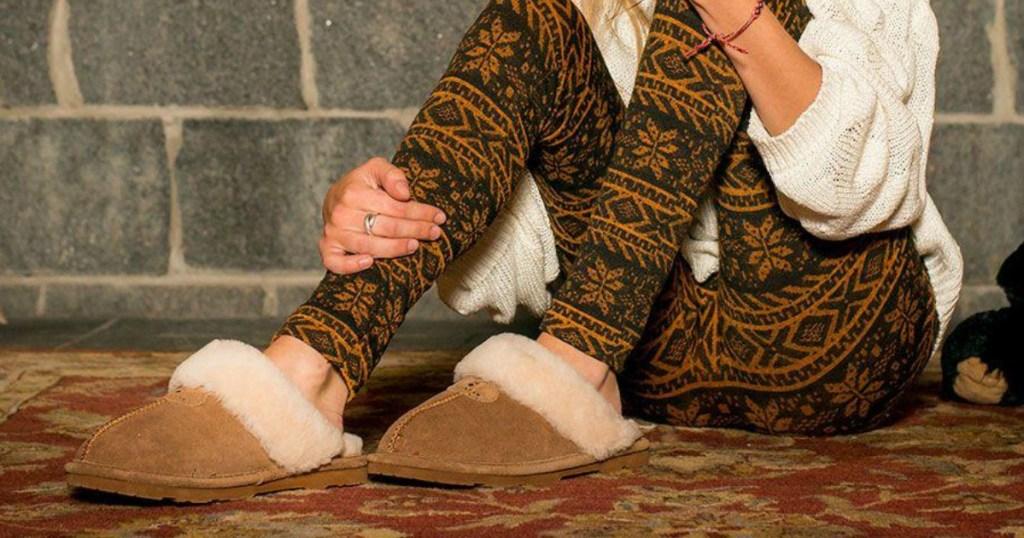 person wearing Bearpaw slippers