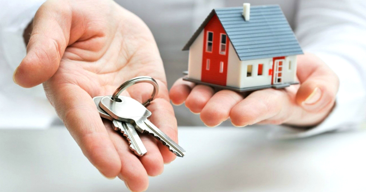 Hand outstretched with keys and a small house