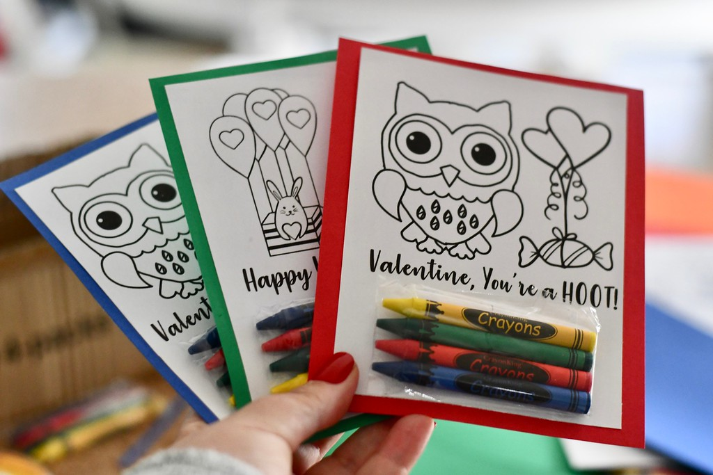 DIY Crayon Valentines fanned out in someone's hand