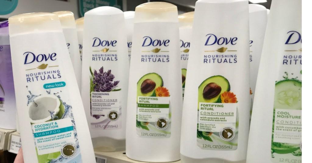 four bottle of dove shampoo on shelf