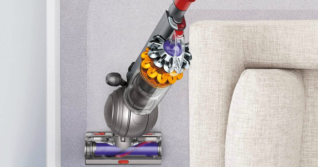 Dyson Vacuum by couch