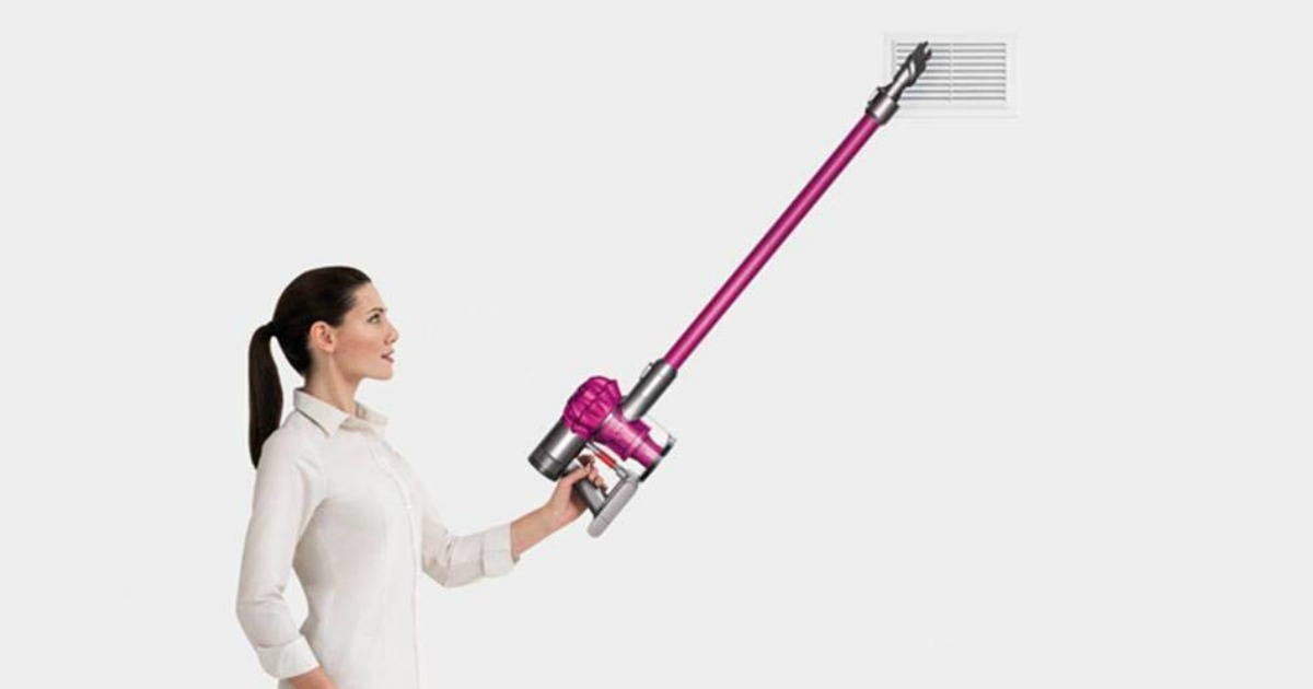 Dyson V6 Cord Free Vacuum being used on an upper air vent