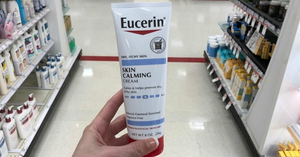 hand holding eucerin skin calming cream