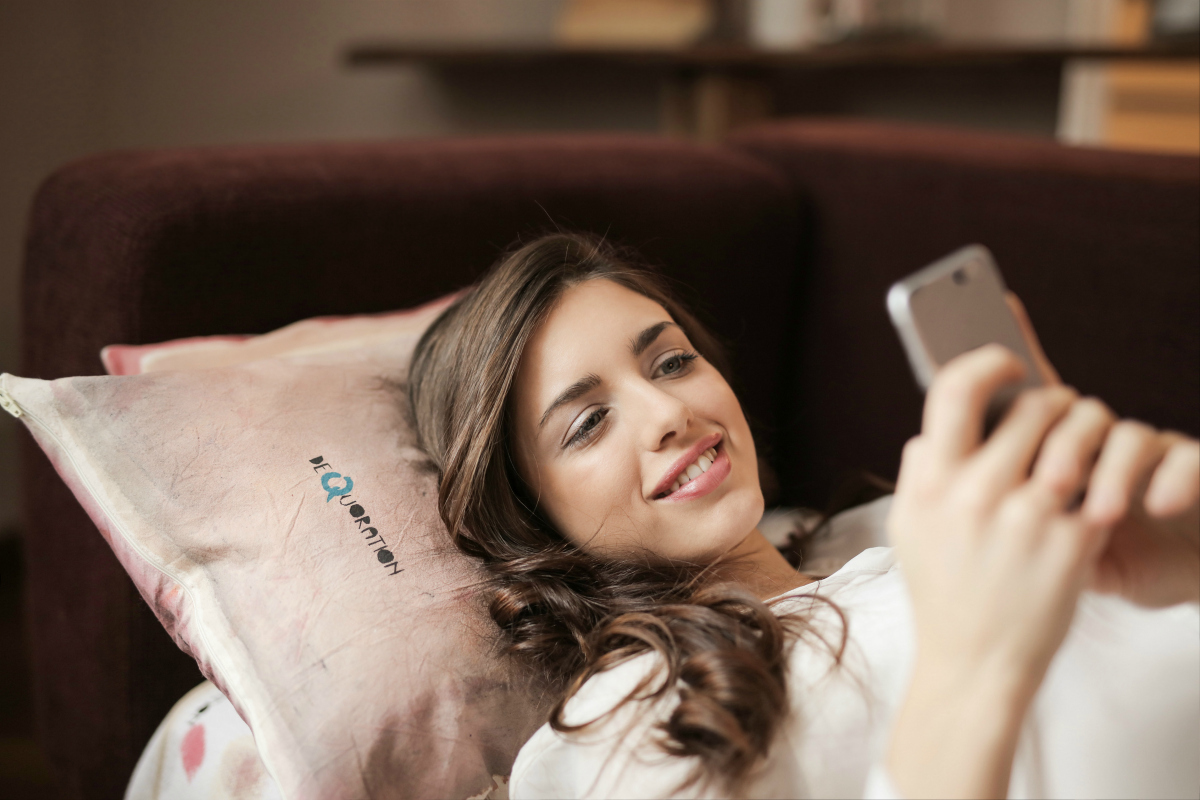 Woman smiling and using an app