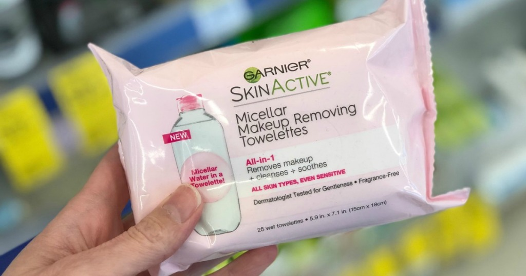 woman holding Garnier Micellar Wipes