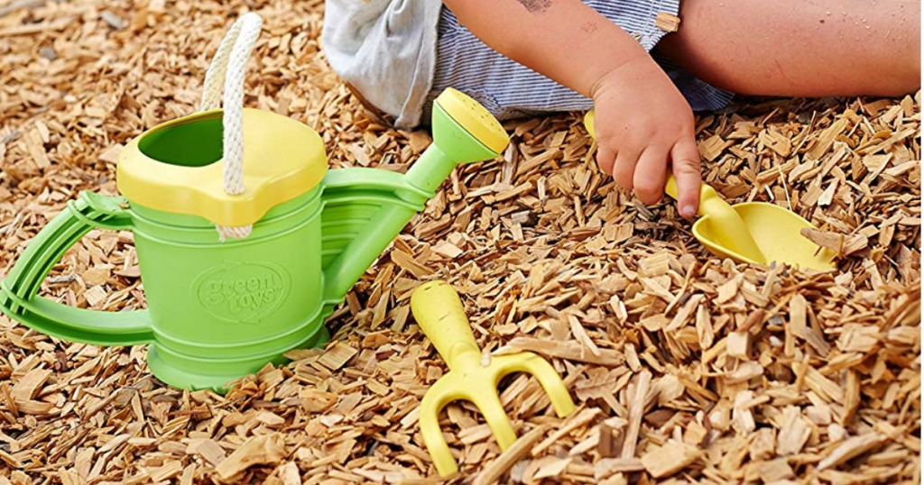 green and yellow gardening toys at playground