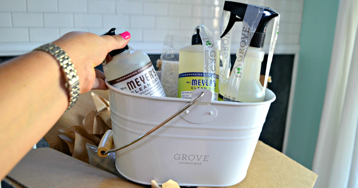 Grove Collaborative caddy with Mrs. Meyer Cleaning supplies inside