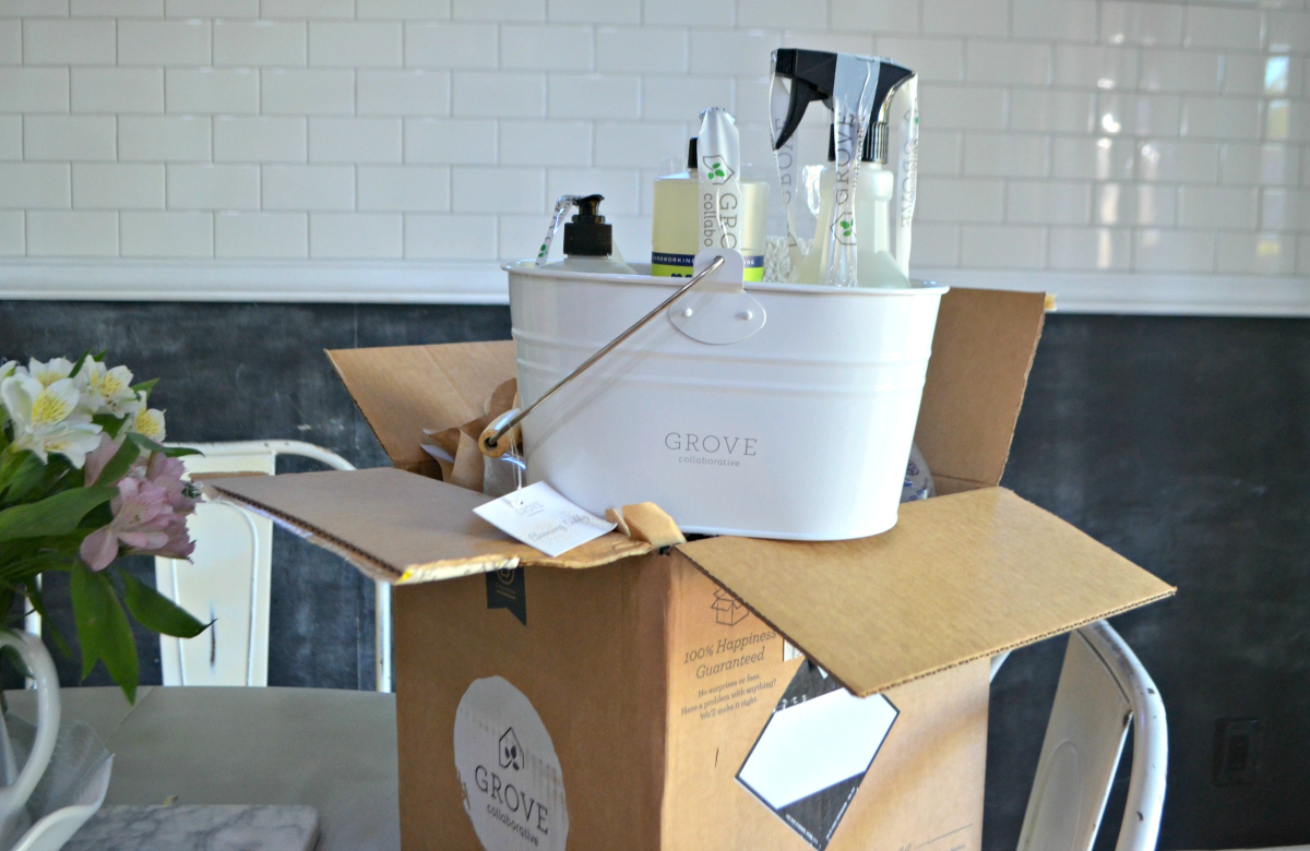 Grove Collaborative items in a tub on top of the shipping box
