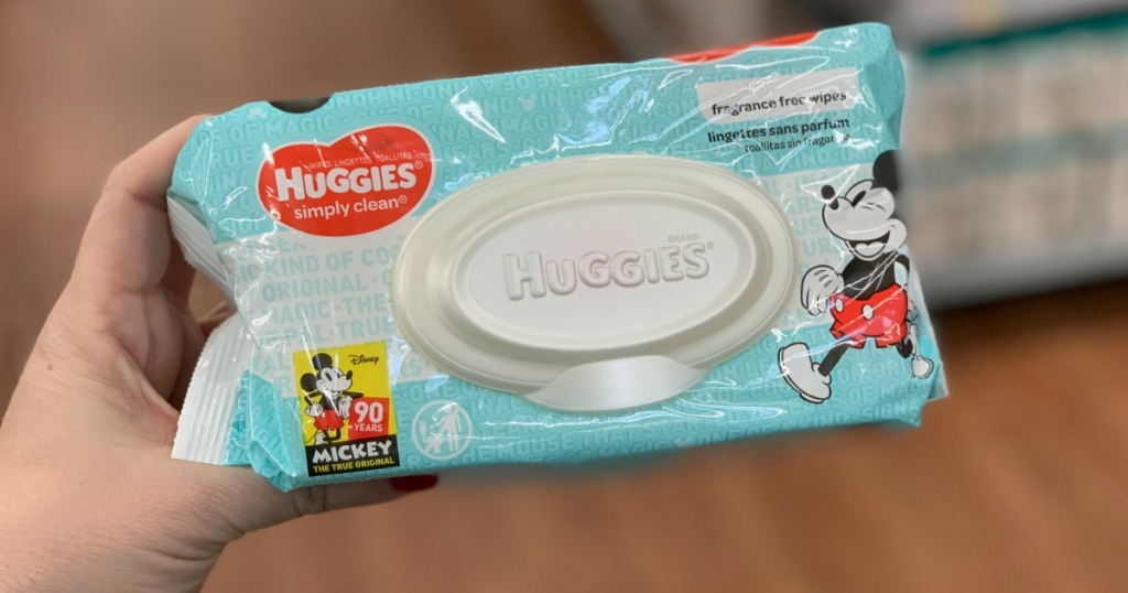 person holding Huggies Wipes
