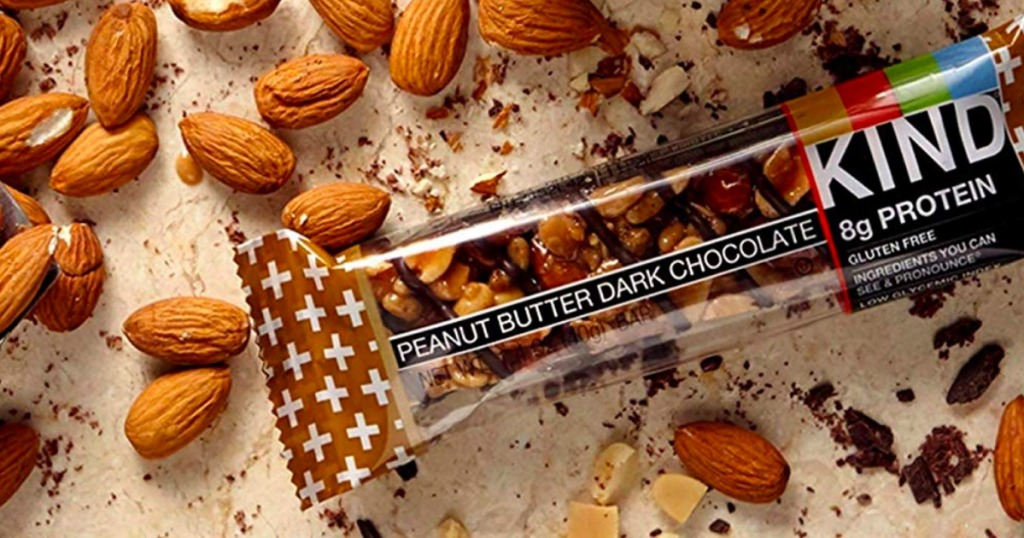 Kind Bars Peanut Butter and dark chocolate bar surrounded by nuts