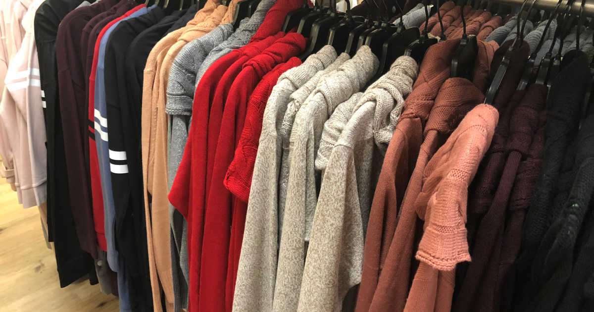 in store photo of sweaters hanging on a rack