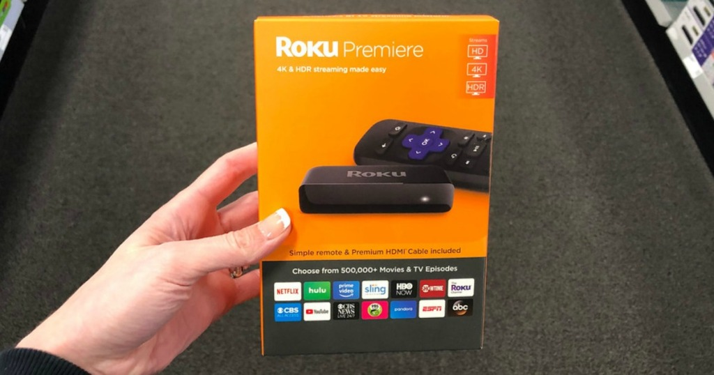 person holding Roku Premiere 4K Streaming Media Player box