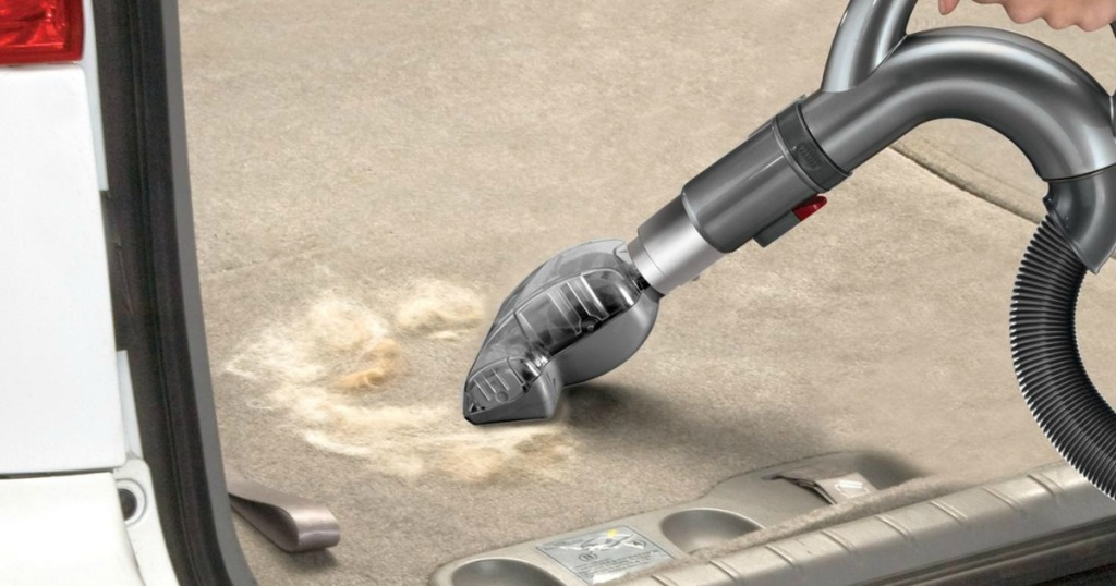 Shark Navigator Professional Lift-Away Upright Vacuum hose attachmetn used in the back of a car