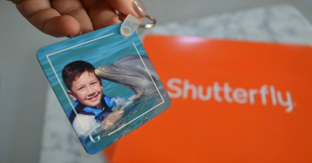 custom keychain next to orange Shutterfly envelope