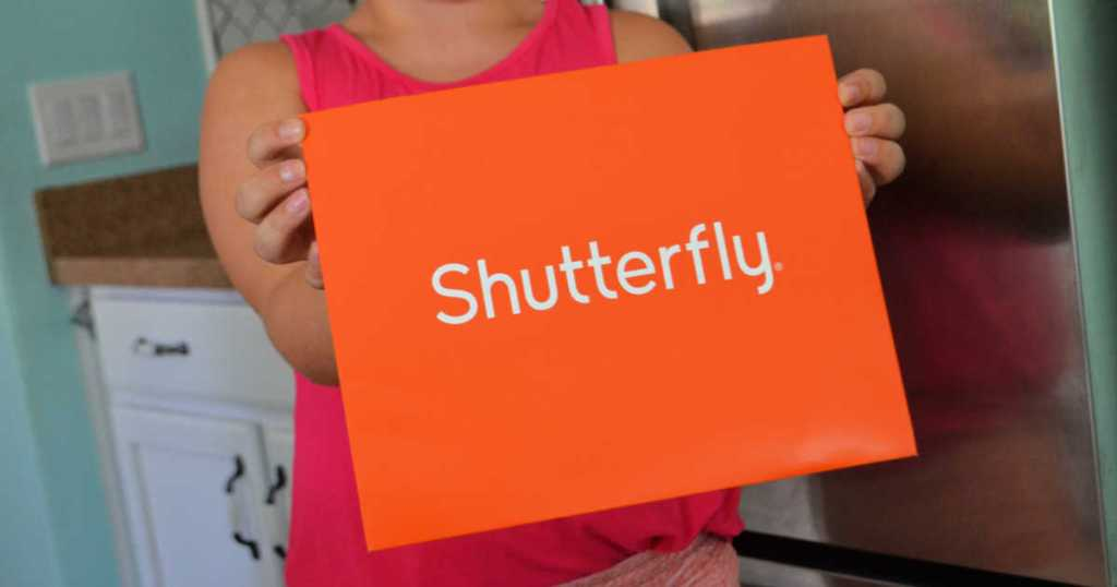 Woman holding large Shutterfly envelope