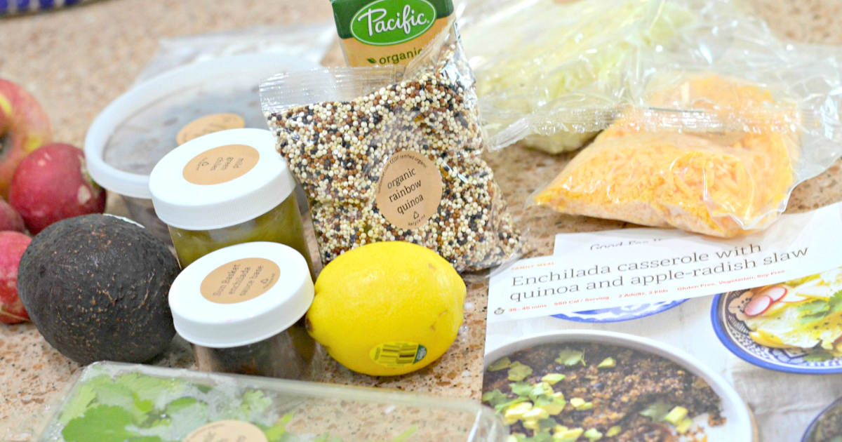 Sun Basket ingredients and recipe cards on a kitchen counter