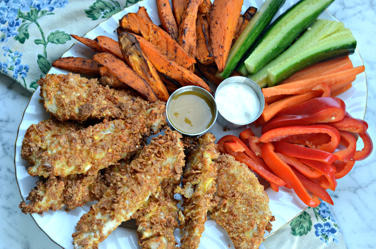 Sun Basket chicken tenders with roasted and fresh veggies on a plate